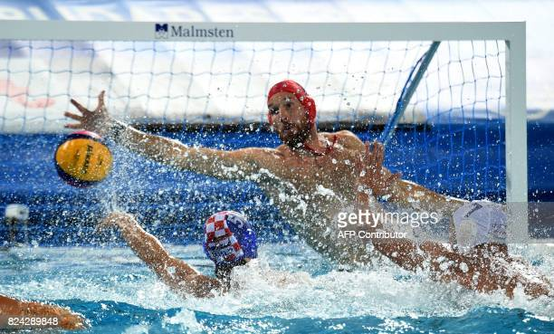 Croatia's Sandro Sukno scores a goal against Hungary's goalkeeper Viktor Nagy in 'Hajos Alfred' swimming pool of Budapest on July 29 2017 during the...