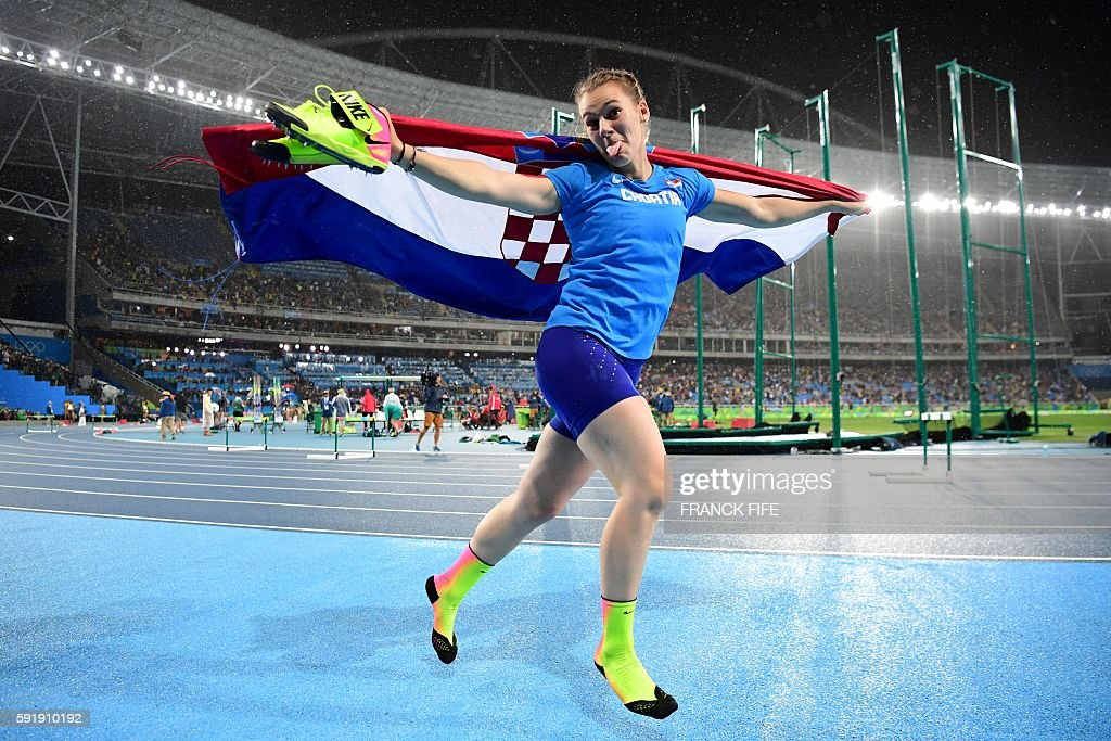 TOPSHOT - Croatia's Sara Kolak celebrates winning the Women's Javelin Throw Final during the athletics event at the Rio 2016 Olympic Games at the Olympic Stadium in Rio de Janeiro on August 18, 2016. / AFP / FRANCK