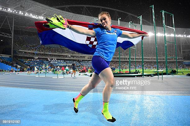 Croatia's Sara Kolak celebrates winning the Women's Javelin Throw Final during the athletics event at the Rio 2016 Olympic Games at the Olympic...