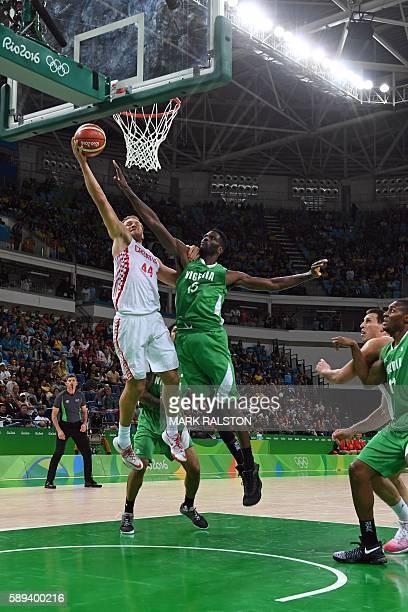 Croatia's shooting guard Bojan Bogdanovic goes to the basket against Nigeria's centre Ekene Ibekwe during a Men's round Group B basketball match...