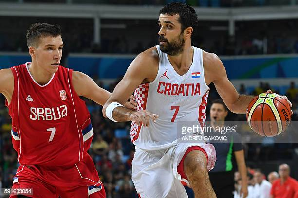 Croatia's shooting guard Krunoslav Simon vies with Serbia's shooting guard Bogdan Bogdanovic during a Men's quarter final basketball match between...