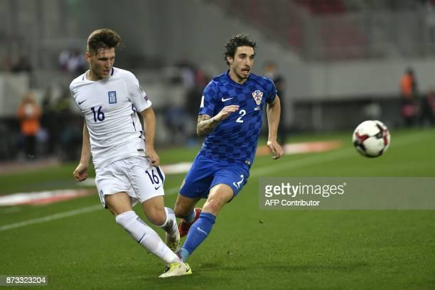 Croatia's Sime Vrsaljko vies with Greece's Panagiotis Retsos during the World Cup 2018 playoff football match Greece vs Croatia on November 12 2017...