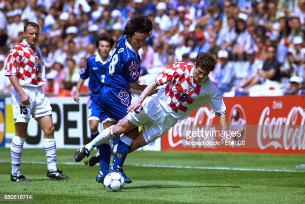 Croatia's Slaven Bilic is upended by the tackle of Japan's Shoji Jo