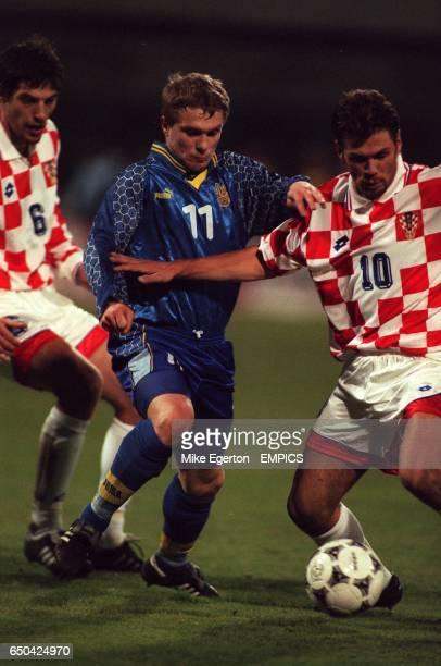 Croatia's Slaven Bilic watches as teammate Zvonimir Boban holds off Serhii Rebrov of Ukraine