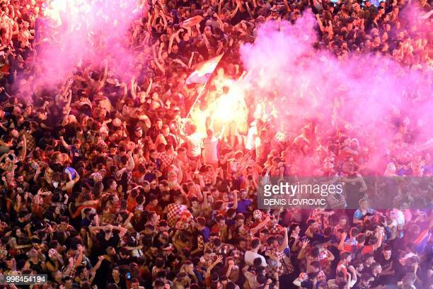 Croatia's supporters celebrate the second goal as they watch on a giant screen the Russia 2018 World Cup semi-final football match between Croatia...
