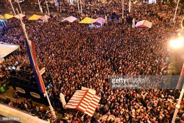 Croatia's supporters watch on a giant screen the Russia 2018 World Cup semi-final football match between Croatia and England, at the main square in...