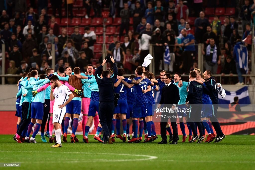 Croatia's team celebrates after winning the World Cup 2018 play-off football match Greece vs Croatia, on November 12, 2017 in Piraeus. /