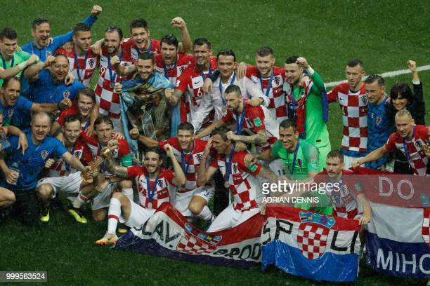 Croatia's team players pose for pictures as they celebrate during the trophy ceremony after arriving second at the end of the Russia 2018 World Cup...