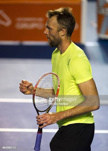 Croatia's tennis player Ivo Karlovic gestures after scoring a point against US player Ryan Harrison during the Mexico ATP tournament in Acapulco...
