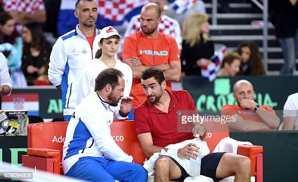 Croatia's tennis player Marin Cilic speaks with Croatia's national team Zeljko Krajan during the Davis Cup World Group final singles match between...