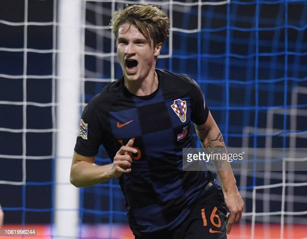 Croatia's Tin Jedvaj celebrates after scoring a goal during the UEFA Nations League football match between Croatia and Spain at the Maksimir Stadium...