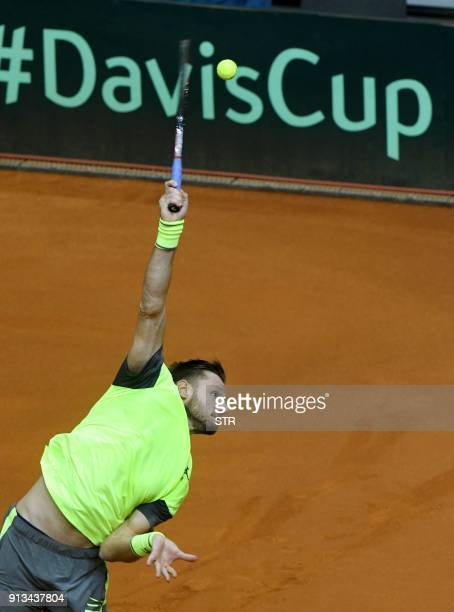 Croatia's Viktor Galovic serves the ball to Canada's Denis Shapovalov during the singles match of the first round of the Davis Cup tennis match...