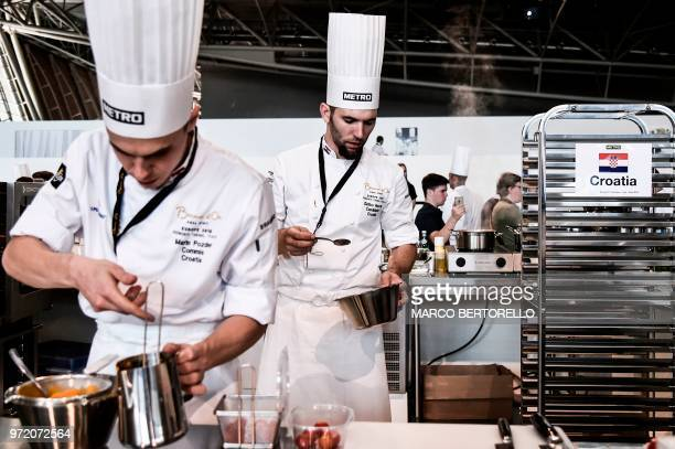 Croatia's Zlatko Novak and Marin Pozder compete during the event of the Bocuse d'Or Europe 2018 International culinary competition on June 12 2018 in...