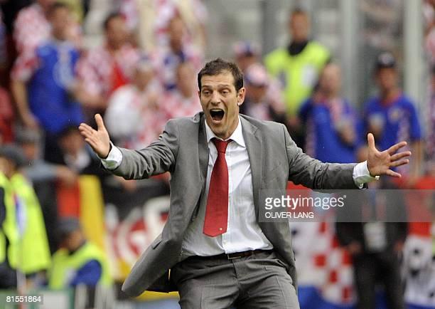 Croation national football team coach Slaven Bilic celebrates after Croatian midfielder Darijo Srna scored the opening goal against Germany during...