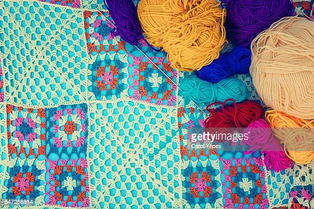 Crochet handmade colorful blanket and some balls of yard
