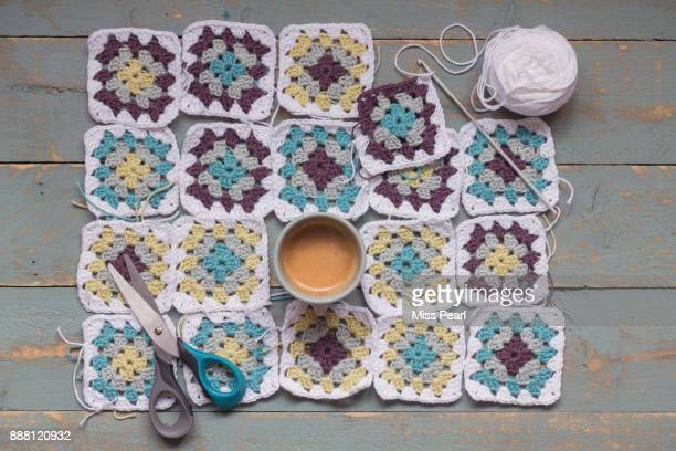Crochet squares work in progress with coffee