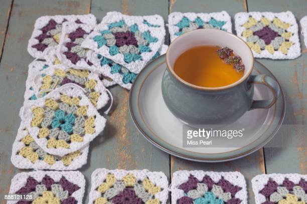 Crochet squares work in progress with tea for one