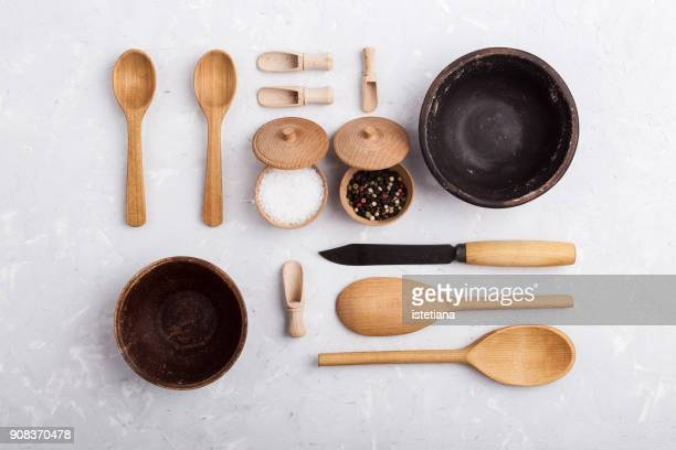 crockery and wooden kitchen utensils knolling style - kitchenware shop stock pictures, royalty-free photos & images