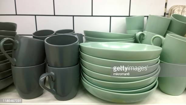 crockery, porcelain, white utensils and other different stuff on shop - essentials collection stock pictures, royalty-free photos & images