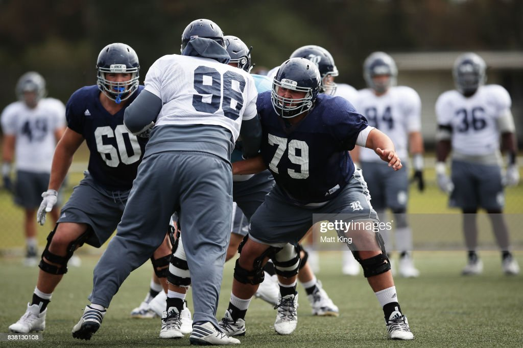 Crockett Mokry #60, Zach Abercrumbia #96 and Joseph Dill #79 during a Rice University College Football training session at David Phillips Sports Complex on August 24, 2017 in Sydney, Australia.