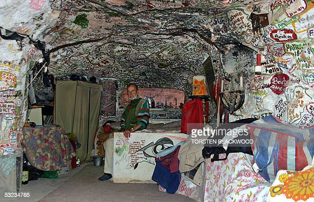 Crocodile Harry a onetime Latvian baron Waffen SS trooper and crocodile hunter sits in the bedroom of his underground home decorated with women's...