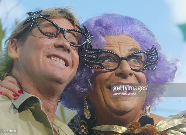 Crocodile Hunter Steve Irwin and Dame Edna Everage perform during a live television broadcast on the US Discovery Channel at Australia Zoo June 13,...
