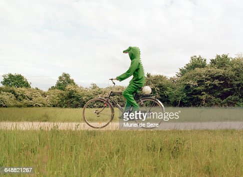 Crocodile on bicycle