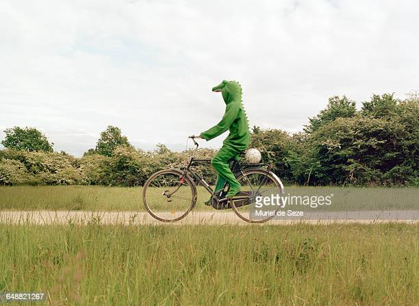 crocodile on bicycle - man made stock pictures, royalty-free photos & images