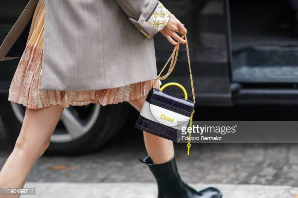 Crocodile pattern Chloe bag with a yellow handle is seen, outside Chloe, during Paris Fashion Week - Womenswear Spring Summer 2020, on September 26,...