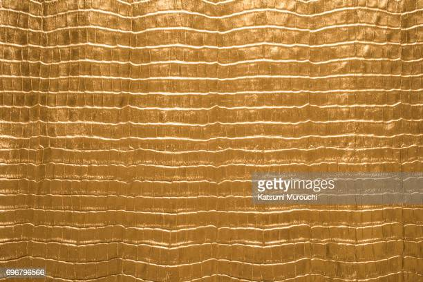 Crocodile pattern gold leather texture background