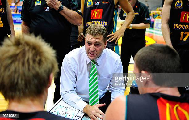 Crocodiles coach Trevor Gleeson talks to his team during three quarter time during the round 14 NBL match between the Townsville Crocodiles and the...
