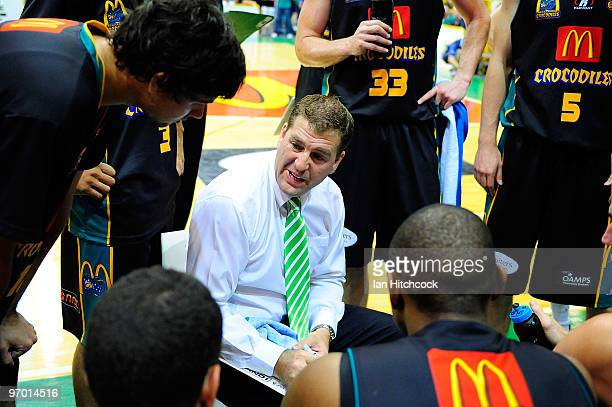Crocs coach Trevor Gleeson talks to his palyers during a time out during game two of the NBL semi final series between the Townsville Crocodiles and...