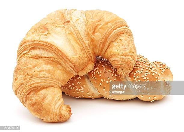 Croissant  and sesame roll isolated on white