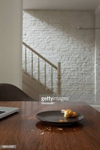 Croissant in plate on table