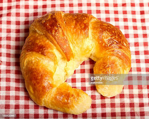 Croissant on a tablecloth for breakfast