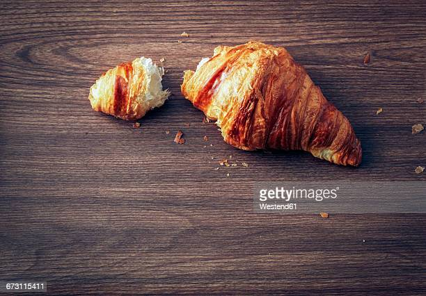 Croissant on dark wood