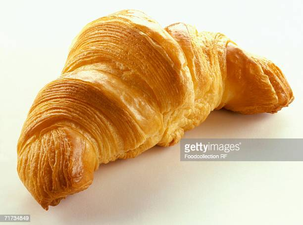 A croissant on white background