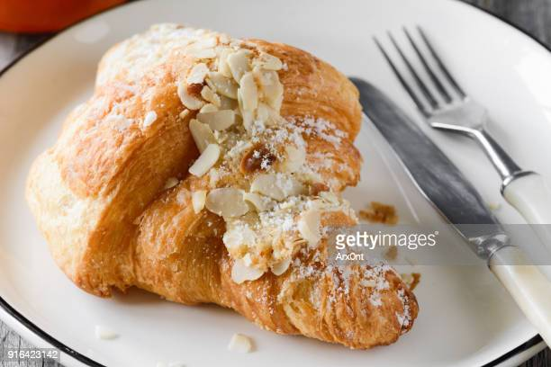 Croissant with almond flakes