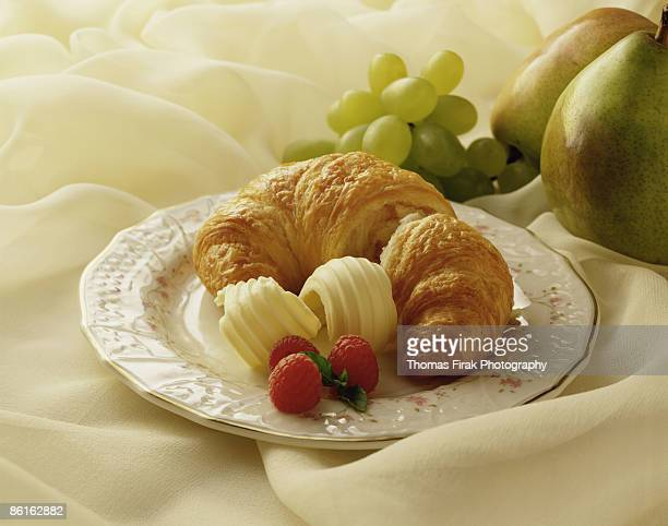 croissant with butter and fruit -  firak stock pictures, royalty-free photos & images