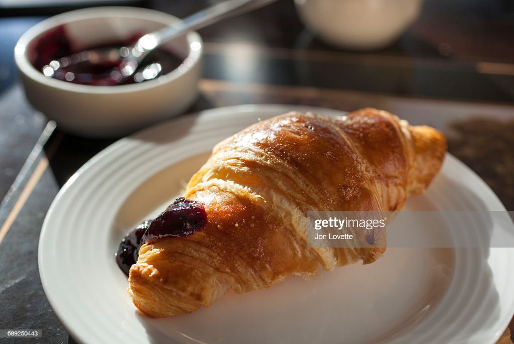 Croissant with dollop of jam : Stock Photo