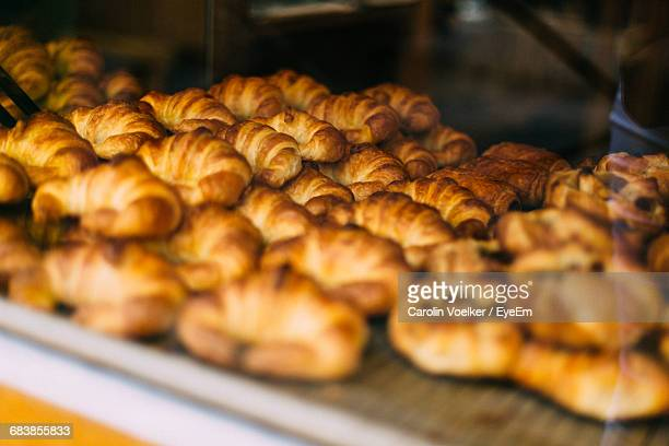 Croissants At Bakery For Sale Seen Through Glass