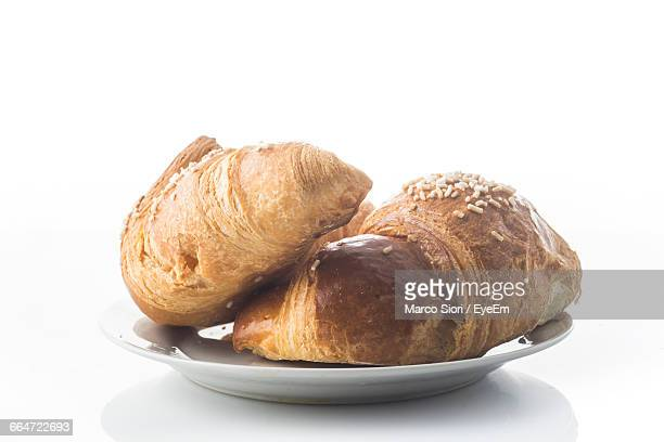 Croissants In Plate Against White Background