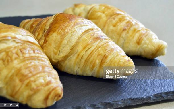 Croissants on a black plate