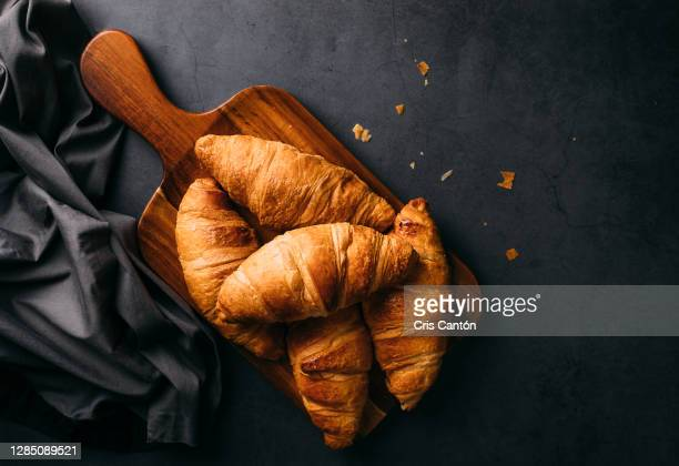 croissants on wooden board - french culture stock pictures, royalty-free photos & images