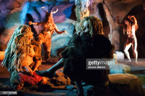 Cro-Magnon dolls sit in a cave in Schiffweiler, Germany, 16 May 2013. It is part of an exhibition at 'Gondwana - Das Praehistorium' that opens on 18...