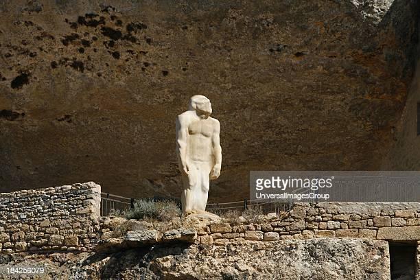 CroMagnon Man statue Museum of Prehistory Les Eyzies Dordogne Aquitaine France travel tourist destination hilltown