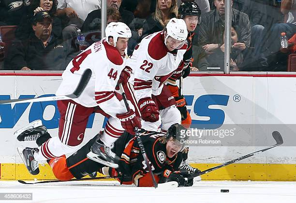 Crombeen and Brandon McMillan of the Arizona Coyotes battle for the puck against Hampus Lindholm of the Anaheim Ducks on November 7, 2014 at Honda...