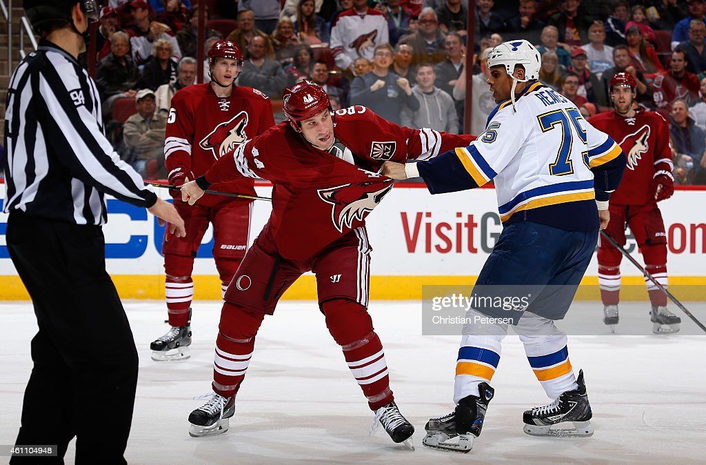 B.J. Crombeen #44 of the Arizona Coyotes fights with Ryan Reaves #75 of the St. Louis Blues during the second period of the NHL game at Gila River Arena on January 6, 2015 in Glendale, Arizona. The Blues defeated the Coyotes 6-0.