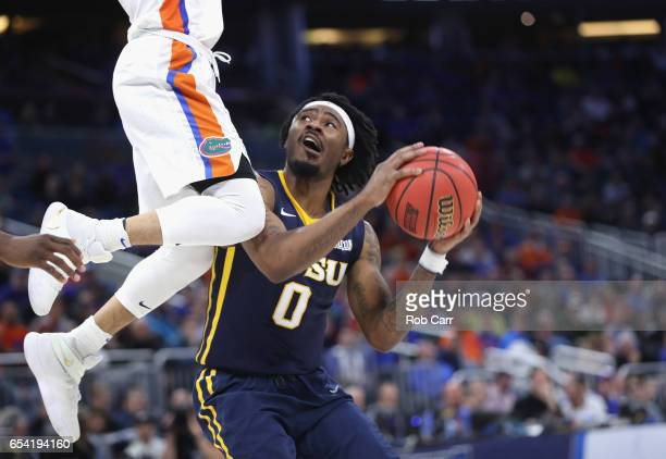 J Cromer of the East Tennessee State Buccaneers drives to the basket against Chris Chiozza of the Florida Gators during the first round of the 2017...