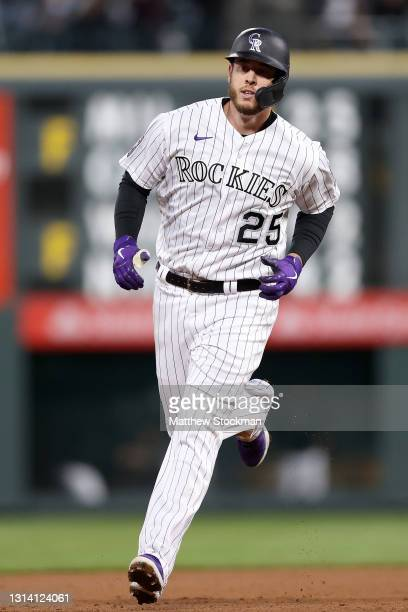 Cron of the Colorado Rockies circles the bases after hitting a solo home run against the Philadelphia Phillies in the fourth inning at Coors Field on...